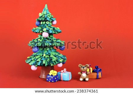 Clay Chrismas tree with gifts and teddy bear