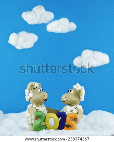 Clay sheep with numbers 2015 and blue sky