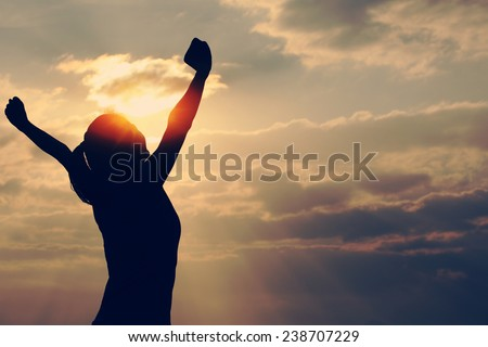 Strong confidence woman open arms under the sunrise at seaside  Royalty-Free Stock Photo #238707229