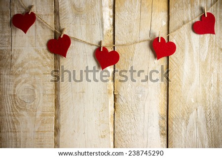 Red hearts hanging over wooden background #238745290