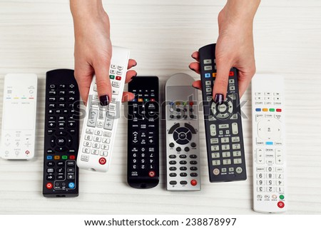 Many remote control devices in hands #238878997