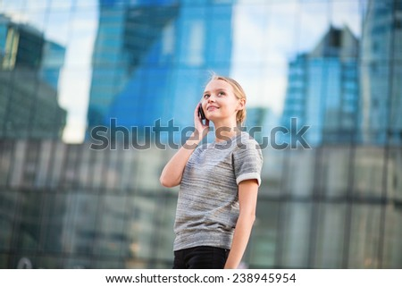 Young beautiful business woman in modern glass interior speaking on the phone #238945954