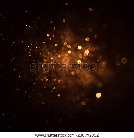 glitter vintage lights background. dark gold and black. defocused