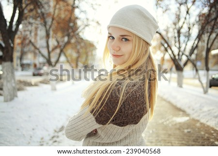 portrait of a young blonde girl in winter forest in the park #239040568