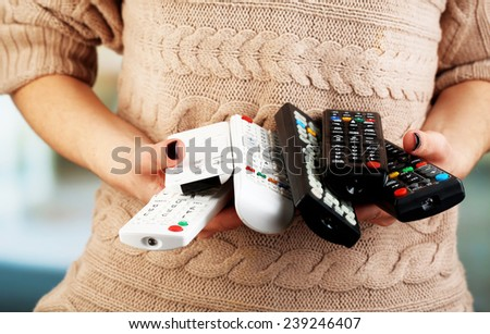 Many remote control devices in in hands #239246407