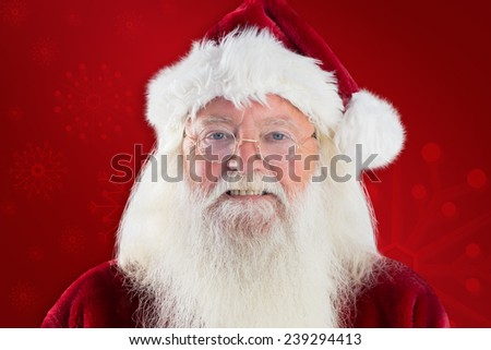 Santa smiles in the camera against red background #239294413