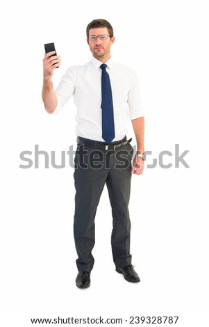 Serious businessman holding his phone on white background #239328787