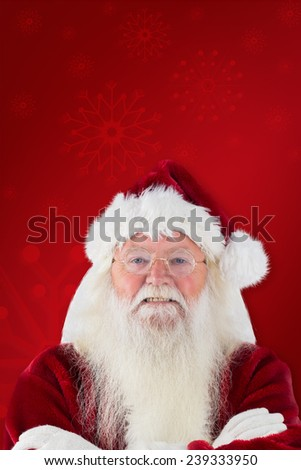 Santa smiles with folded arms against red background #239333950