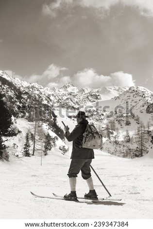 Vintage photos old skier with traditional old wooden skis #239347384