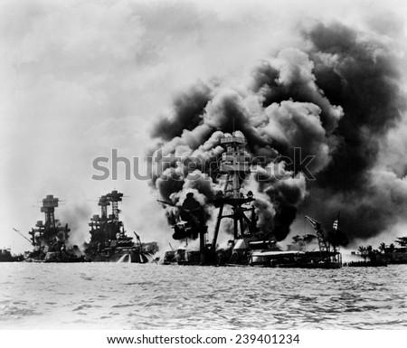 Pearl Harbor: three stricken U.S. battleships. Left to right: U.S.S. West Virginia, severely damaged; U.S.S. Tennessee, damaged; and U.S.S. Arizona, sunk, December 7, 1941