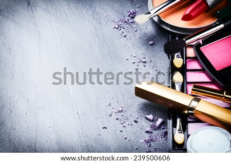 Various makeup products on dark background with copyspace Royalty-Free Stock Photo #239500606