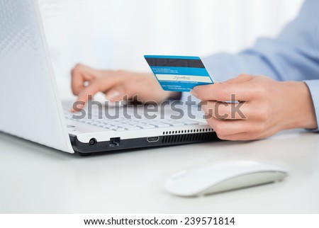 Close up of female hands making online payment #239571814