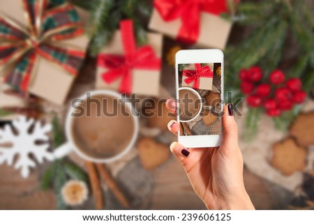 Hands taking picture of gingerbread cookies