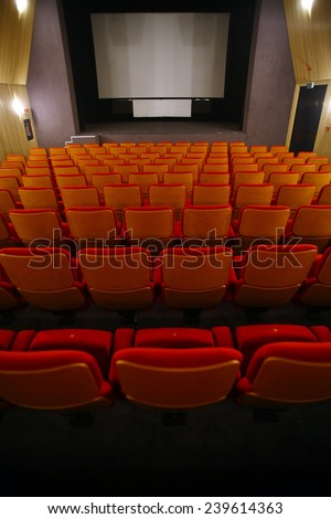 Color vertical shot of some seats in a cinema hall. #239614363
