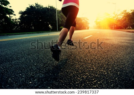 Runner athlete running at road. woman fitness sunrise jogging workout wellness concept.  #239817337