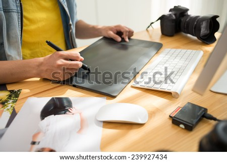 Cropped image of photographer retouching a photo