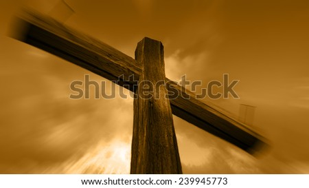 Wooden cross against the sky with shining rays #239945773