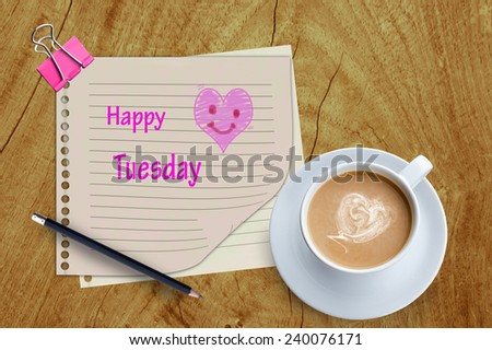 Happy tuesday word and coffee cup on wooden background.