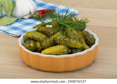 Pickled small cucumber with dill and spices #240076537