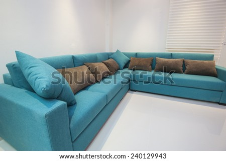 Corner sofa with cushions in luxury apartment living room #240129943