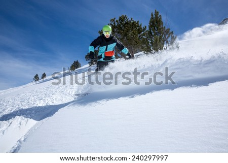 Freerider snowboarder moving down in snow powder  #240297997