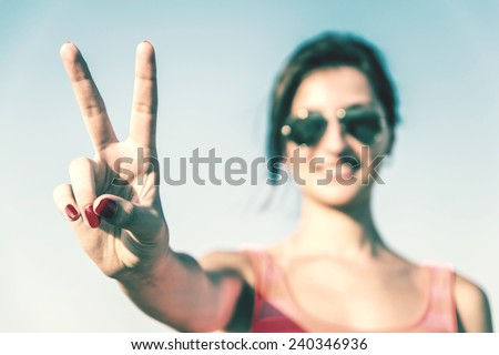 Retro Photo Of Young Girl With Victory Sign #240346936