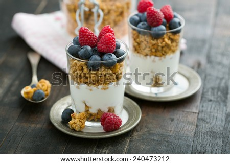 granola with fruits on vintage wooden table #240473212