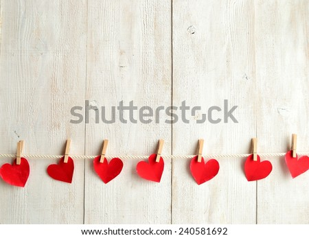 Red heart paper cut with clothes pin on white wooden background.Image of Valentines day #240581692