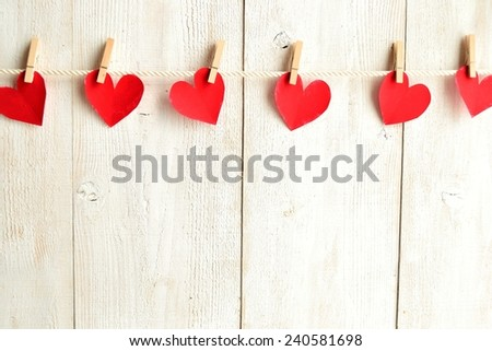 Red heart paper cut with clothes pin on white wooden background.Image of Valentines day #240581698