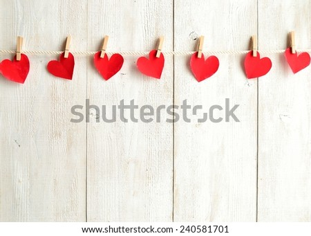 Red heart paper cut with clothes pin on white wooden background.Image of Valentines day #240581701