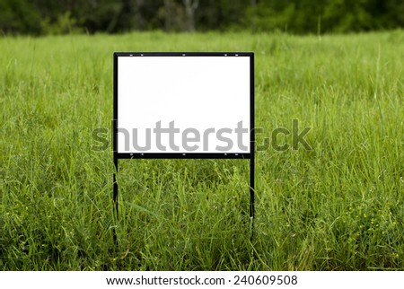 Horizontal Shot Of Blank Sign In Field/ Put Your Copy On This Sign