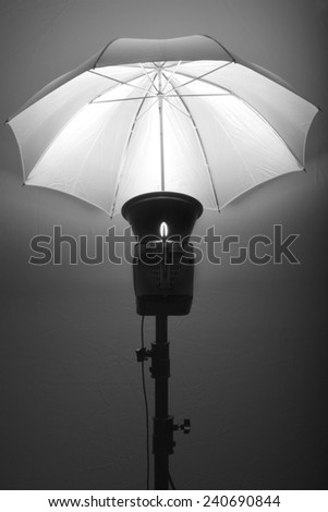 Detail of studio flash strobe light and umbrella on stand strobist professional photographer #240690844