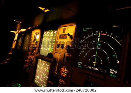 Light from a plane control  room in the dark. #240720082