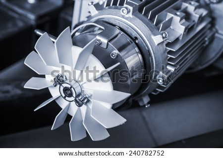 Modern electric motor fragment, blue toned photo Royalty-Free Stock Photo #240782752