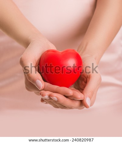 Woman with heart in hands, give love, valentine's day, closeup #240820987