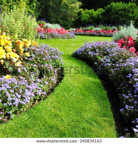 Grass Path and Flowerbed in a Beautiful Garden #240834163