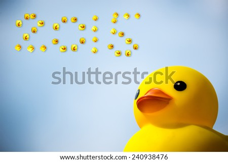 Happiness yellow rubber duck amd blue sky happy new year 2015