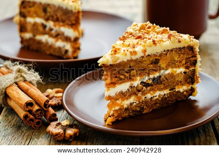carrot cake with walnuts, prunes and dried apricots on a dark wood background. tinting. selective focus Royalty-Free Stock Photo #240942928