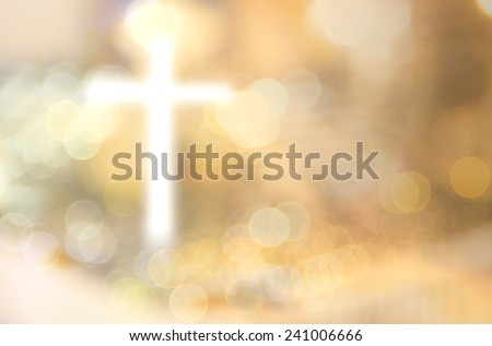 Good Friday concept: Abstract blurred white cross over bokeh light sunset background
