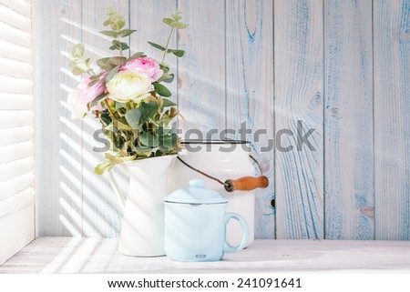 Morning still life on shabby chic table and  light from the blinds #241091641
