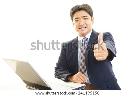 Smiling businessman with thumbs up #241195150