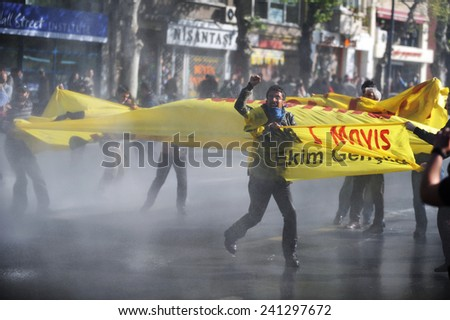 ISTANBUL, TURKEY-MAY 1: Turkish police fired water cannon and tear gas to prevent protesters from defying a ban on May Day rallies and reaching Taksim Square on May 1, 2009 in Istanbul, Turkey. #241297672