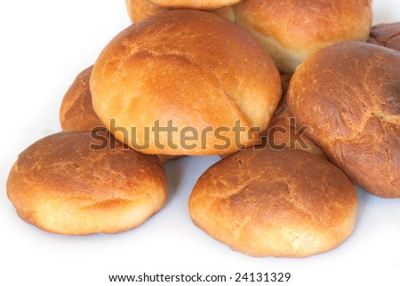 Fresh small bread on a light background #24131329