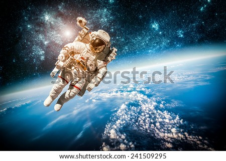 Astronaut in outer space against the backdrop of the planet earth. Elements of this image furnished by NASA. #241509295