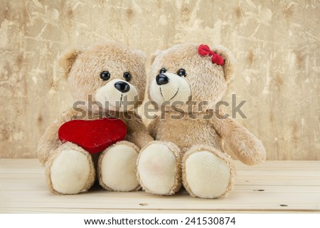 two teddy Bear with Heart on wood grunge background,concept valentine ,vintage retro tone
