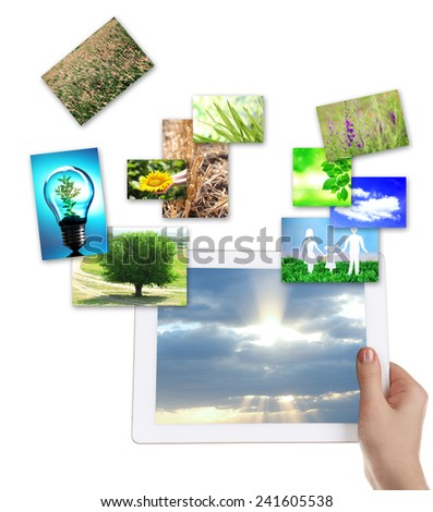 Tablet PC in hand and images of nature objects isolated on white #241605538