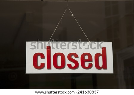 Closed Sign on Shop Window #241630837