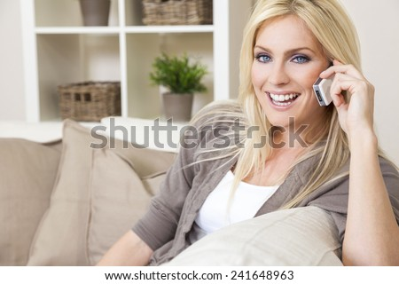 A beautiful young woman talking on her cell phone at home #241648963