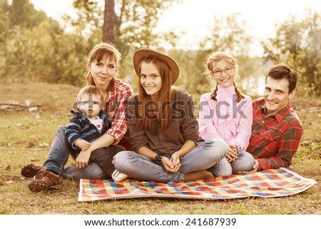 Happy family have a picnic outdoor #241687939