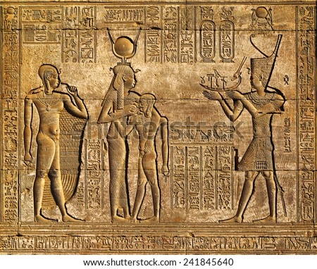 Hieroglyphic carvings on the exterior walls of an ancient egyptian temple  #241845640